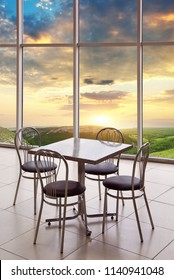 Table, chairs and nature mountain sunset. Restaurant element of design.