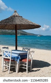 Table and chairs on the beach, Greece