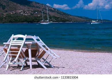 Table and chairs on the beach, Greeece