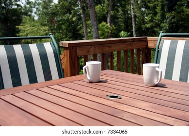 A table and chairs on a deck