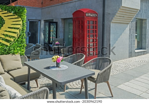 table-chairs-on-summer-terrace-600w-2030