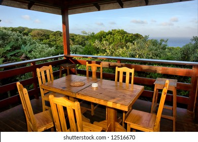 Table with chairs on terrace in sunset. Shot in Sodwana Bay campsite, KwaZulu-Natal province, Southern Mozambique area, South Africa.