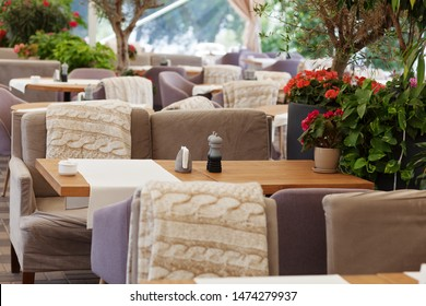 Table and chairs in park cafe. Modern design interior. Concept of vacation and leisure