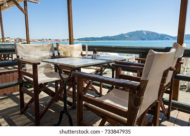 Table and chairs at patio with a panoramic sea view.