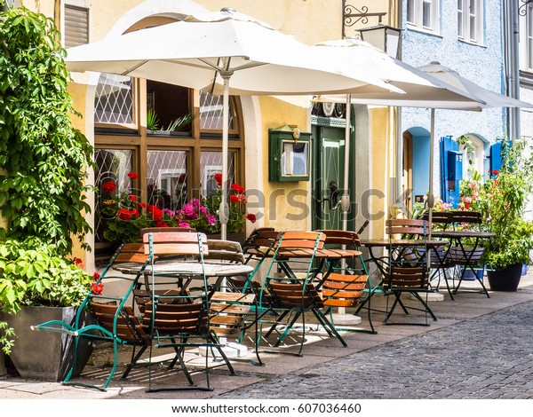 table and chairs at a sidewalk cafe