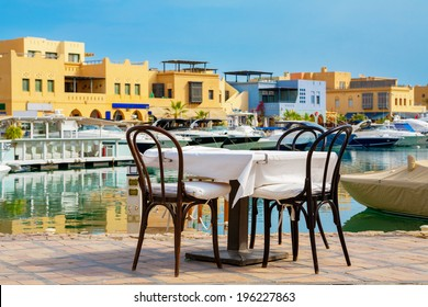 Table and chairs in sidewalk cafe at Abu Tig Marina. El Gouna, Red Sea, Egypt