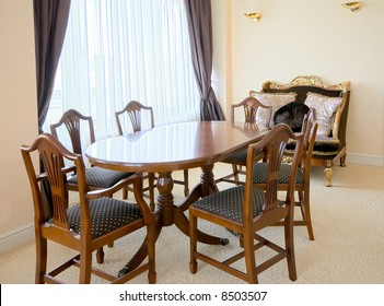 table and chairs in sitting-room interior