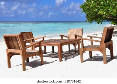 Table and chairs at tropical beach restaurant, Thinadhoo island, Vaavu atoll, Maldives