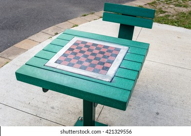 Table with Chessboard in a Park