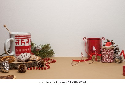 table with christmas decoration and cup of tea