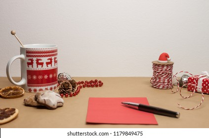 table with christmas decoration and wish list