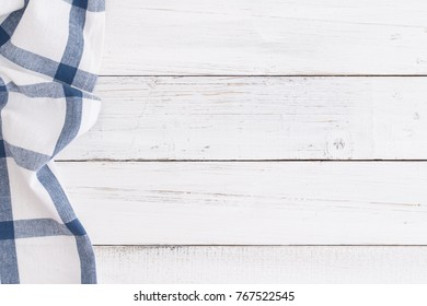Table cloth blue on white table wood,top view and copy space for background