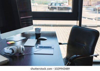 table with computer and cup of coffee in business office