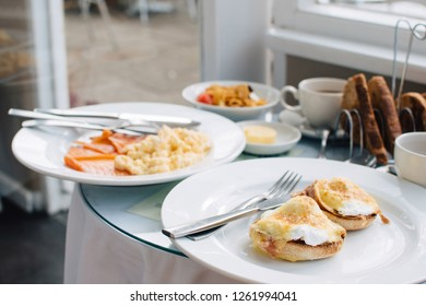 Table with a continental breakfast with tea, coffee and scrambled eggs