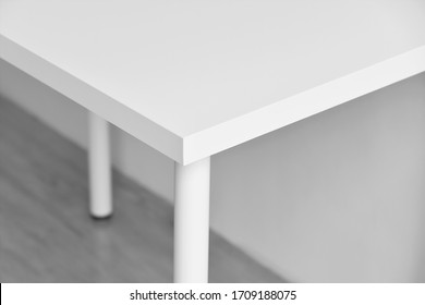 Table corner, Sharp desk edge, Home accident from furniture, White table with hard angle, Minimal style and copyspcae for wording.