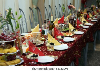 The table covered by a holiday with drinks and various dishes