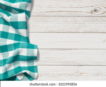 table with cyan picnic cloth top view background
