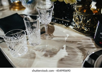 Table decor. Elegant glassware stands on a white table
