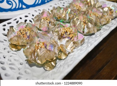 Table decorated with chocolate candy and peanuts