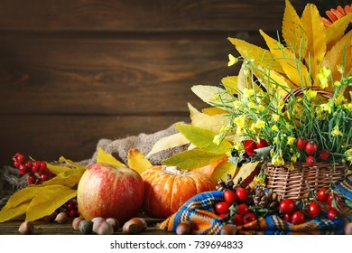 The table decorated with flowers and vegetables. Happy Thanksgiving Day. Autumn background.