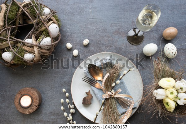 Table decoration with champagne for a festive easter dinner