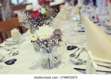 Table decoration on a wedding with flower napkins and candles