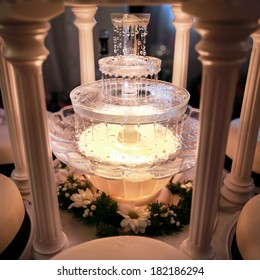 Table decoration at a wedding reception in restaurant. Wine fountain.