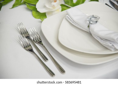 the table decorations in the restaurant, forks, plates, napkin holder