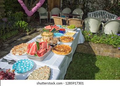 Table with delicious buffet in a summer garden