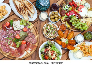 Table with delicious foods, snacks, tapas and appetizers