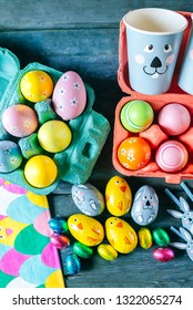 Table with eggs and Easter ornaments.