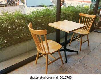 Table and empty chairs in a coffee shop. The coffee shop terrace area. The sun shines.
