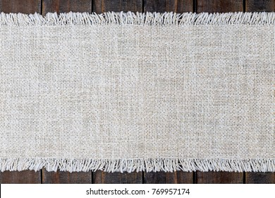 Table fabric linen Runner on wooden table rustic background, copy space