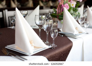 Table with fish dishes and served silverware