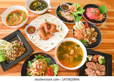 Table food served on plate / Tradition northeast food Isaan delicious on plate with fresh vegetables - Many variety various Thai menu Asian food on a wooden table , top view