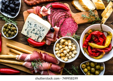 Table with food, tapas bar with spanish cuisine, cured meat, cheese and platter with other appetizers from spain, top view