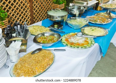 Table with food trays to serve - event