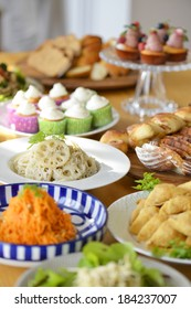 A table of foods and sweets as for a party buffet.