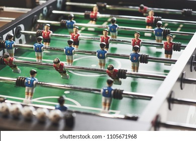 Table football in the entertainment center. Close-up image of plastic players in a football game.