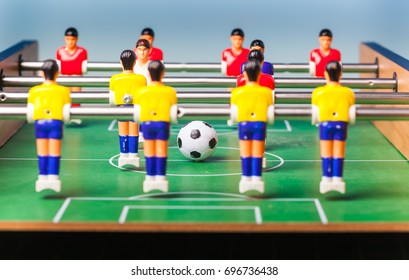 Table football . foosball on a blue background