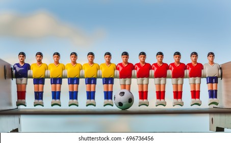 Table football . foosball on a blue background