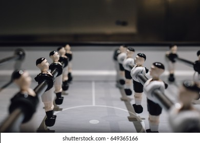 Table football game with black and white players ,Business competition concept , Teamwork