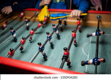 table football game. Table football in the entertainment center. Close-up image of plastic players in a football game. Soccer table mini game. foosball table soccer .sport team football players.