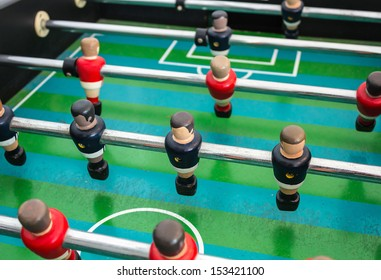 Table football game with red and blue players