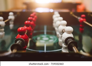 Table football game with red and white players ,Business competition concept , Teamwork