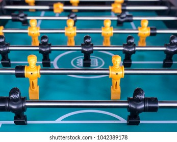 Table football game, Soccer table with yellow and black players