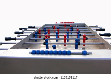 a table football made of metal with small red and blue figures