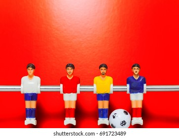 Table football on a red background . foosball