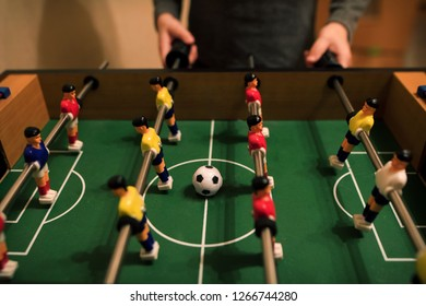Table football with red and yellow players.