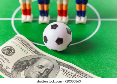 Table football .soccer players ball and dollars on the field.bookmaker concept